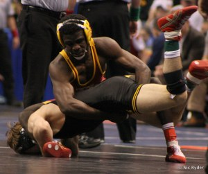 Earl Hall works for a score on Iowa's Cory Clark