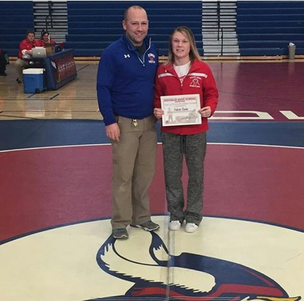 Felicity Taylor of South Winn accepting the Decorah Viking Dual OW award. Photo submitted.